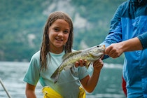 Junior camper smiling with a fish.jpg?ixlib=rails 2.1