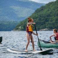 Junior camper paddleboarding.jpg?ixlib=rails 2.1