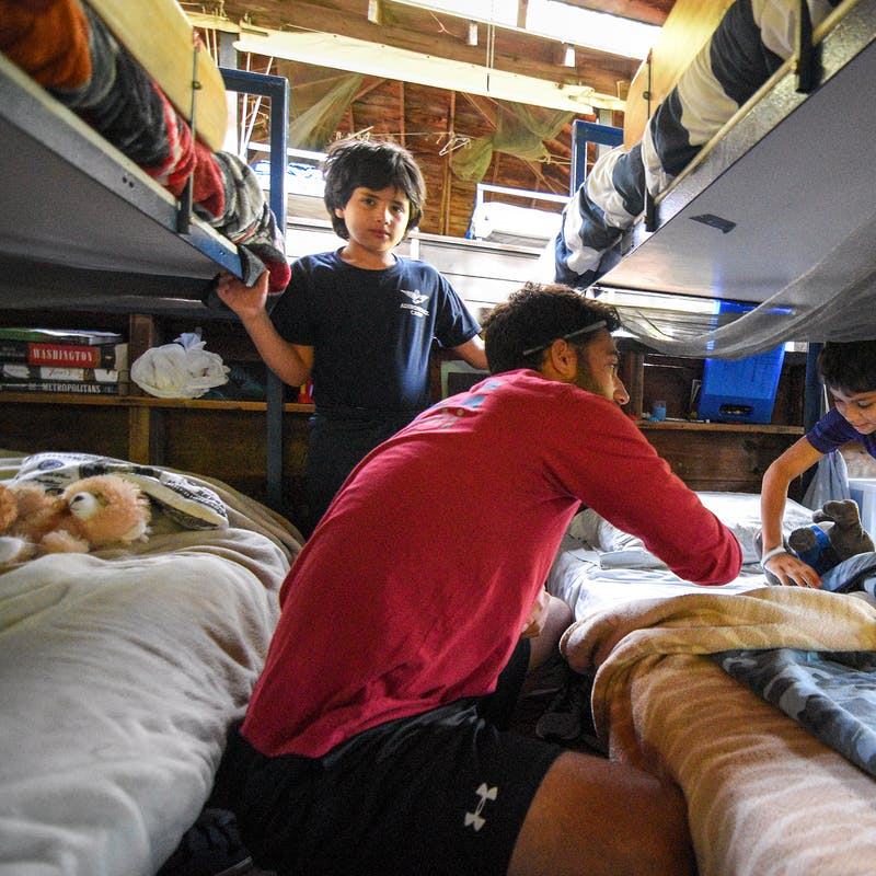 Counselor and camper making a bed.jpg?ixlib=rails 2.1