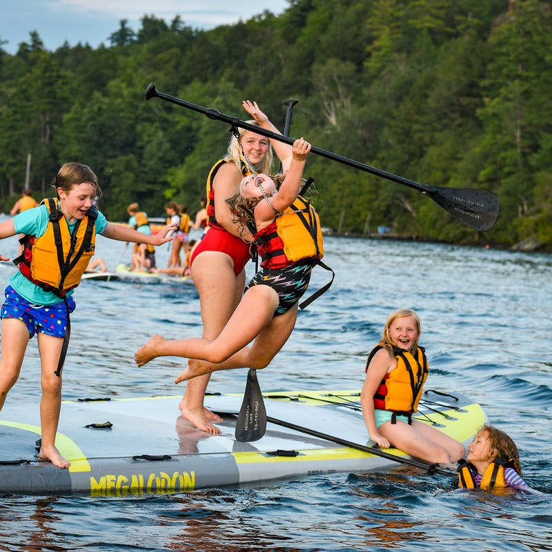 Leaping from a paddleboard on lake george.jpg?ixlib=rails 2.1
