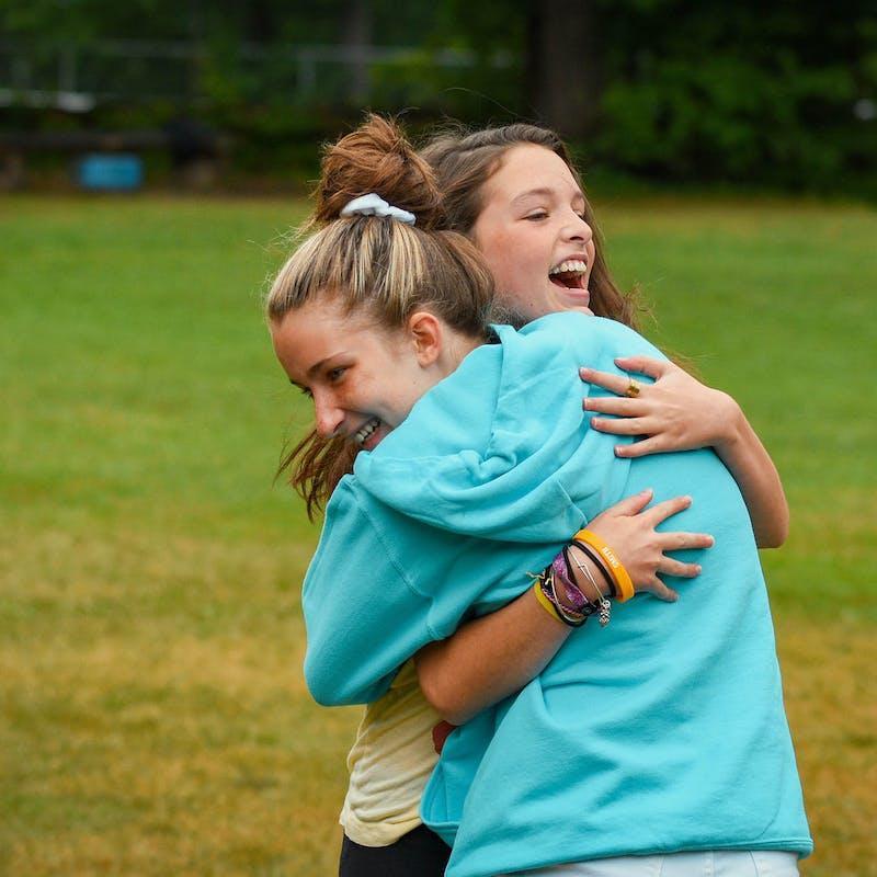 Two friends hugging.jpg?ixlib=rails 2.1