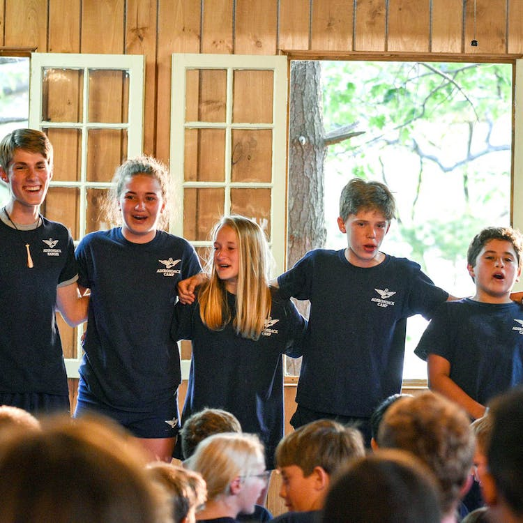 Campers singing in the dining hall.jpg?ixlib=rails 2.1