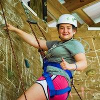 Girl climbing wall at summer camp.jpg?ixlib=rails 2.1