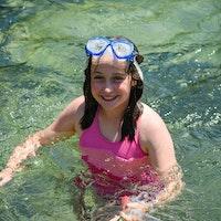 Smiling girl swimming at camp.jpg?ixlib=rails 2.1