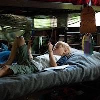 Reading on cabin bunk at kids camp.jpg?ixlib=rails 2.1