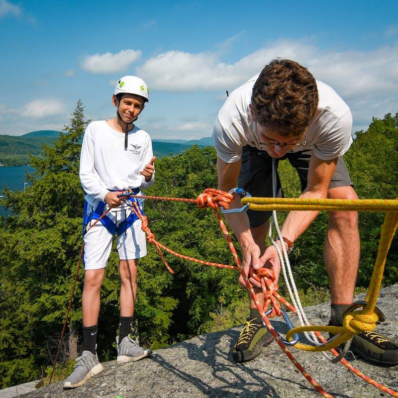 Counselor and climber at camp.jpg?ixlib=rails 2.1