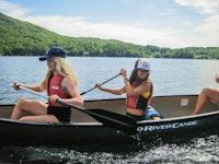 Three girls at canoe.jpg?ixlib=rails 2.1