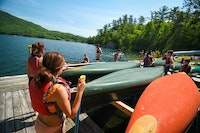 Teens preparing to canoe at camp.jpg?ixlib=rails 2.1