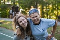 Girls camp staff work at summer camp.jpg?ixlib=rails 2.1