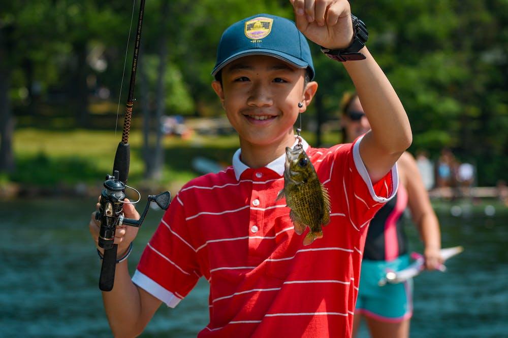 Boy fishing lake george ny summer camp.jpg?ixlib=rails 2.1