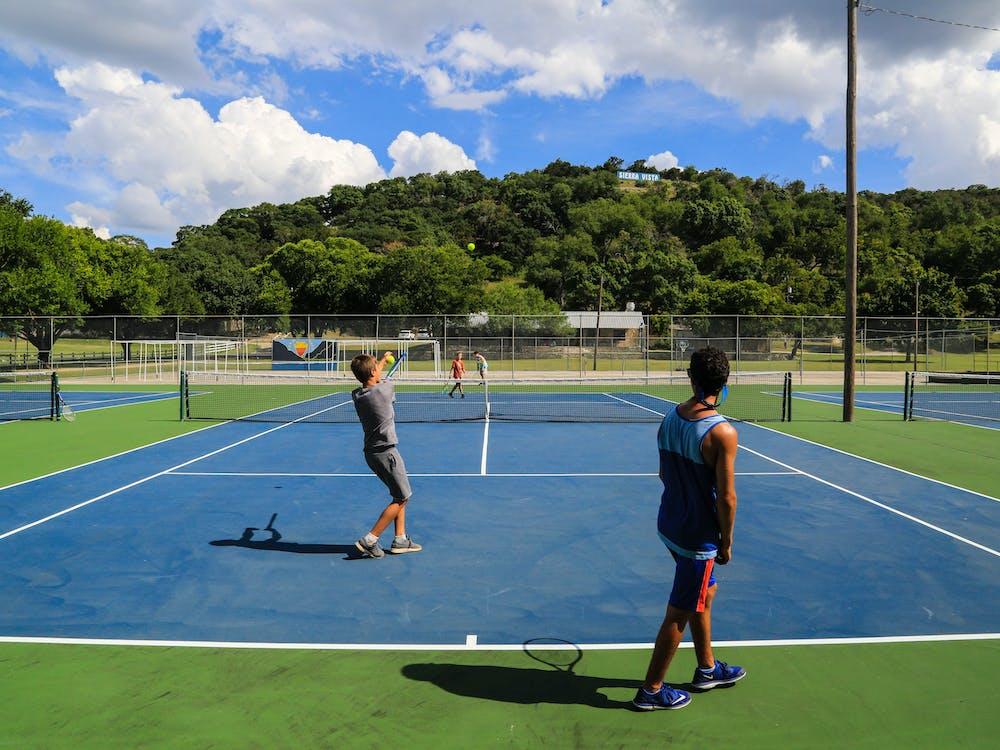 Boys playing tennis summer camp texas.jpg?ixlib=rails 2.1