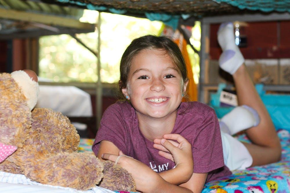 Smiling camper in cabin.jpg?ixlib=rails 2.1