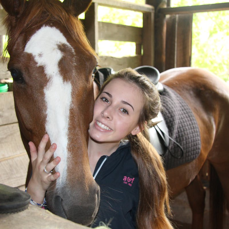 Bella hugging horse.jpg?ixlib=rails 2.1