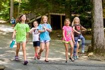 Girls walking through the beautiful camp highlander property.jpg?ixlib=rails 2.1