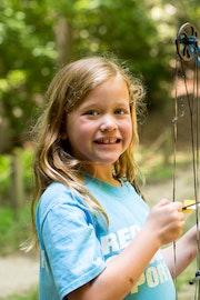 A girl on the archery range at camp highlander north carolina.jpg?ixlib=rails 2.1