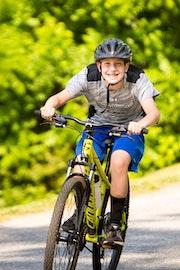 A boy on a mountain bike at camp highlander coed summer camp.jpg?ixlib=rails 2.1