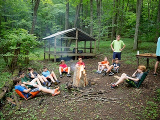 Sitting around campfire at camp highlander coed summer camp north carolina.jpg?ixlib=rails 2.1