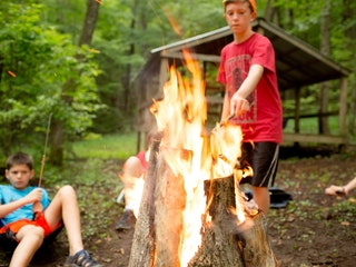 Roasting smoores at camp highlander coed summer camp north carolina.jpg?ixlib=rails 2.1