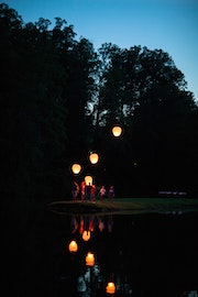 Lighting lanterns at highlander summer camp in north carolina.jpg?ixlib=rails 2.1
