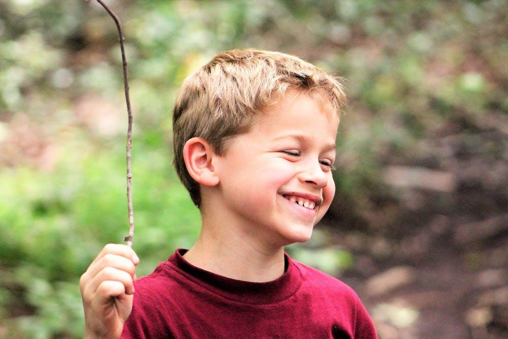 Kid smiling with smore.jpg?ixlib=rails 2.1