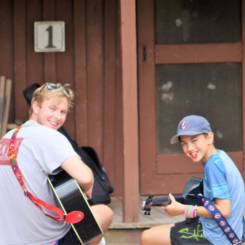 Traditional camp counselor guitar.jpg?ixlib=rails 2.1