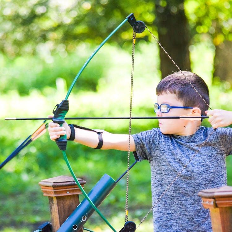 Bestsummercamps texas overnight sleepaway youth play camphuawni activities archery.jpg?ixlib=rails 2.1