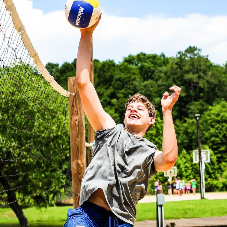 Bestsummercamps texas overnight sleepaway youth play camphuawni activities volleyball.jpg?ixlib=rails 2.1