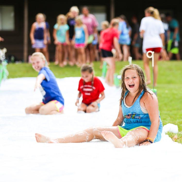 Bestsummercamps texas overnight sleepaway youth play camphuawni specialevents slipenslide.jpg?ixlib=rails 2.1