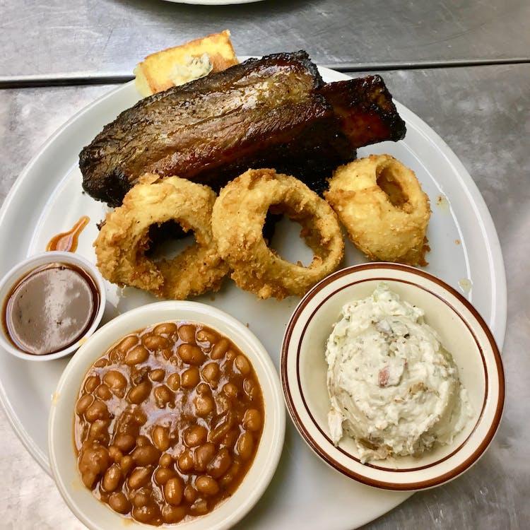 Flat rock nc bbq ribs sauce beans onion rings cornbread.jpg?ixlib=rails 2.1