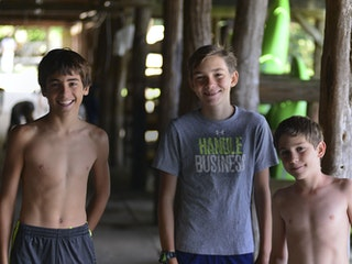 Three boys in dock.jpg?ixlib=rails 2.1