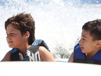 Boys in ski boat.jpg?ixlib=rails 2.1
