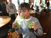 Boys camp dining room eating lettuce.jpg?ixlib=rails 2.1