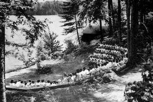 1920 raquette lake girls camp campfire.jpg?ixlib=rails 2.1