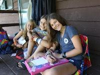 Girls camp writing letters.jpg?ixlib=rails 2.1