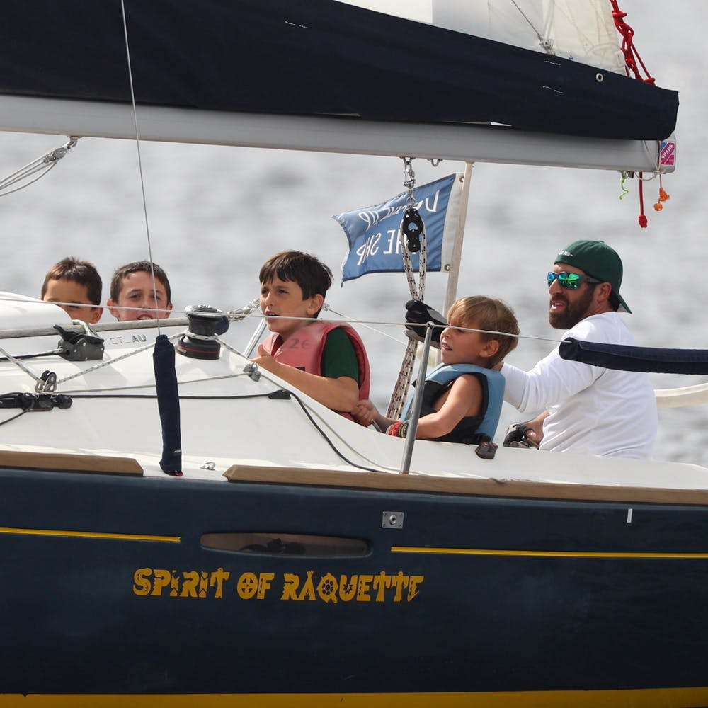 Boys camp sailing with the director.jpg?ixlib=rails 2.1