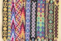 83861655 natural bracelets of friendship in a row colorful woven friendship bracelets background rainbow colo.jpg?ixlib=rails 2.1