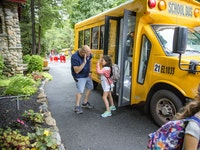 Gregg unloading bus.jpg?ixlib=rails 2.1