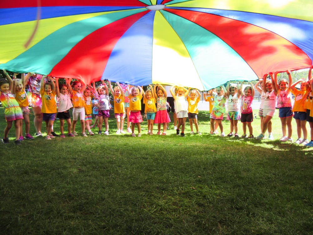 Junior campers with parachute at camp.jpg?ixlib=rails 2.1