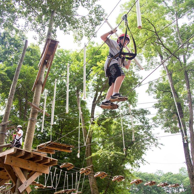 Older boy climbing the ropes course.jpg?ixlib=rails 2.1