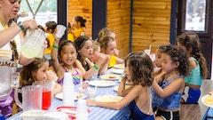 Serving lemonade girls at their table.jpg?ixlib=rails 2.1