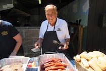 Arthur kessler serving hot dogs.jpg?ixlib=rails 2.1