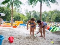 A camper buries her friend in the sand.jpg?ixlib=rails 2.1