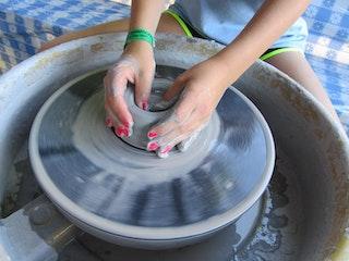 Spinning clay on the pottery wheel.jpg?ixlib=rails 2.1