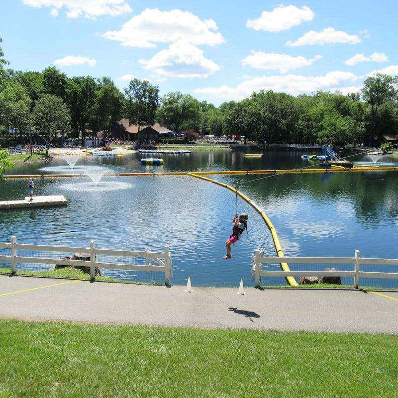 Zip lining over the lake.jpg?ixlib=rails 2.1