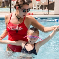 Lifeguard teaching a camper to swim.jpg?ixlib=rails 2.1
