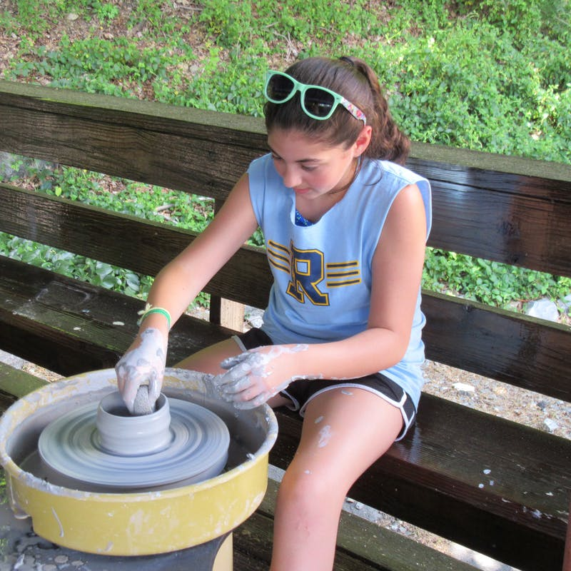 Camper using pottery wheel.jpg?ixlib=rails 2.1