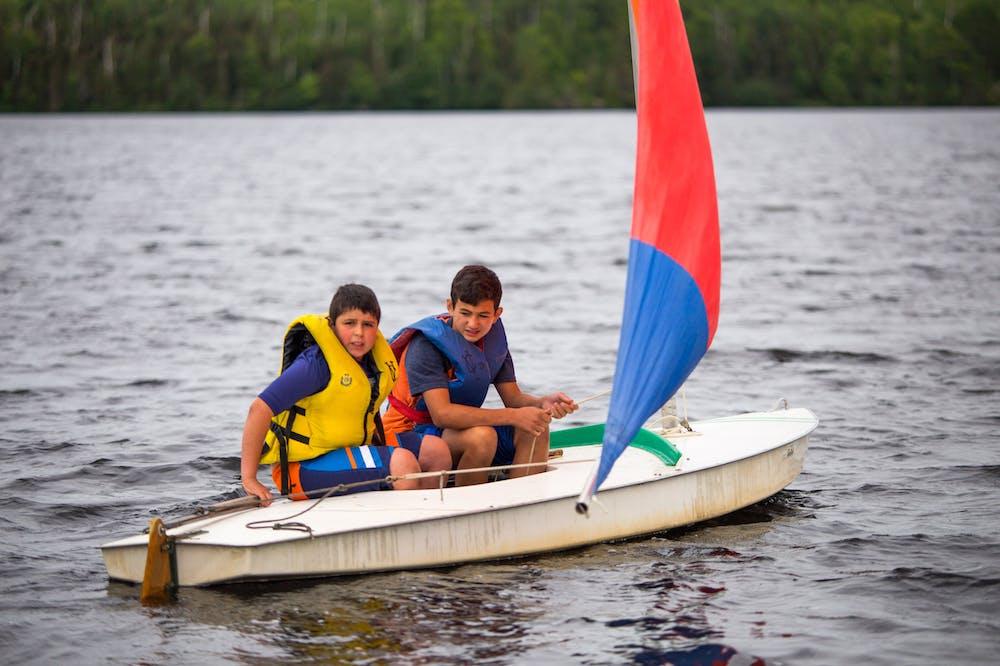Two boys sailing on the lake.jpg?ixlib=rails 2.1