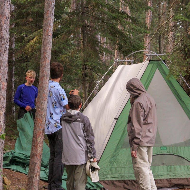 Setting up the tent.jpg?ixlib=rails 2.1