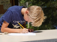 Writing a letter at summer camp.jpg?ixlib=rails 2.1