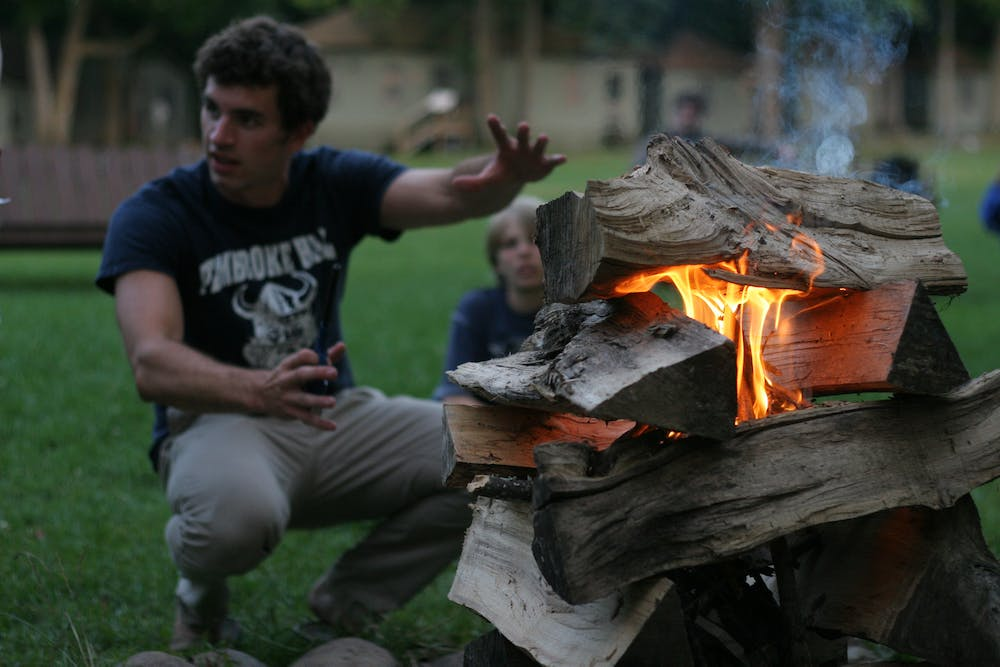 Camp mishawaka summer camp for boys and girls staff campfire.jpg?ixlib=rails 2.1